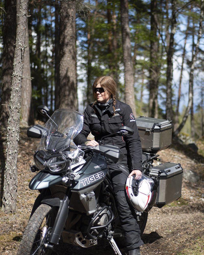 Wilda Nilsson on a motorbike model Triumph Tiger 800