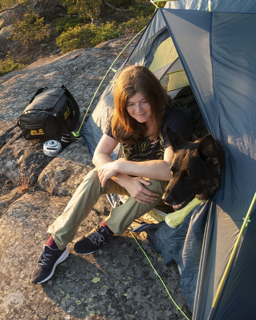 Wilda Nilsson and Flexie the german shepherd in a tent